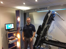 Stockwood Osteopath Adam Balderstone with IDD Therapy